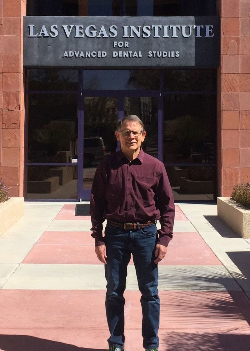 Dr. Pete Nathe standing in front of the entrance to the Las Vegas Institute for Advanced Dental Studies